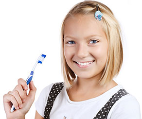 Jan-Blog-Image.  Preteen girl smiling hold a toothbrush
