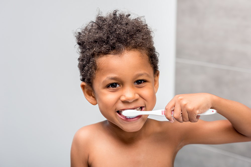 Young boy brushing his teeth.